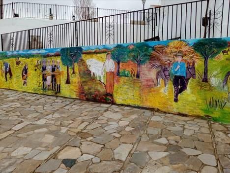 Diputación embellece las calles de Alcudia de Monteagud con un mural inspirado en labores agrícolas tradicionales