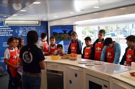 Los escolares se conciencian sobre la alimentación saludable en la caravana 'Act for food'